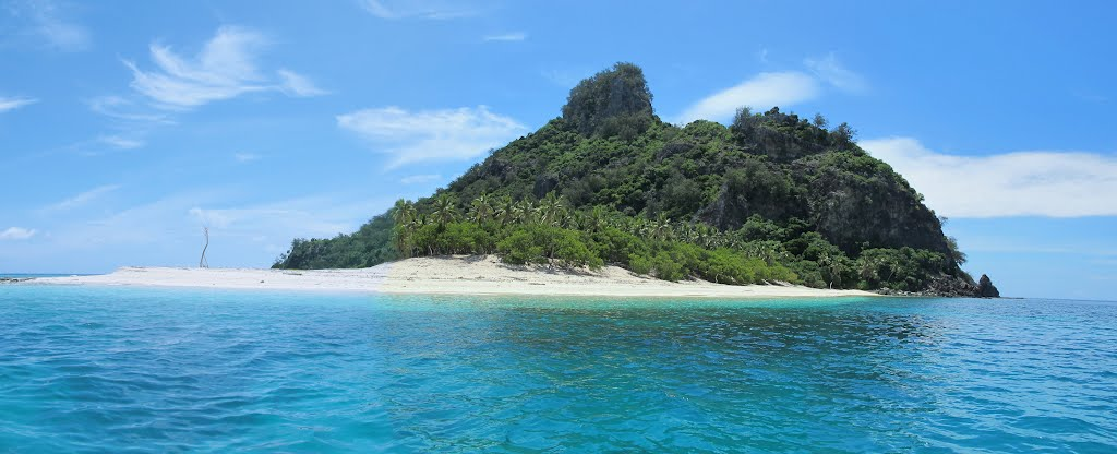deserted island paragraph Describing a tropical island: a setting for a novel or film the beach's water deflects the sun's great glare into his eyes and is forced to look away towards and ever growing jungle of vines, trees and darkness.